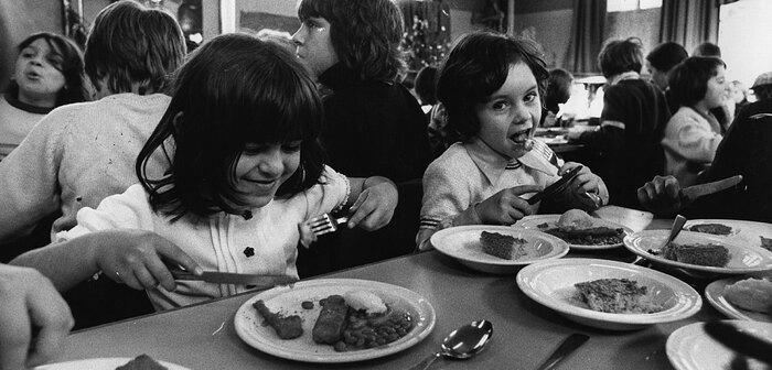 British schoolchildren eating fish sticks in 1974