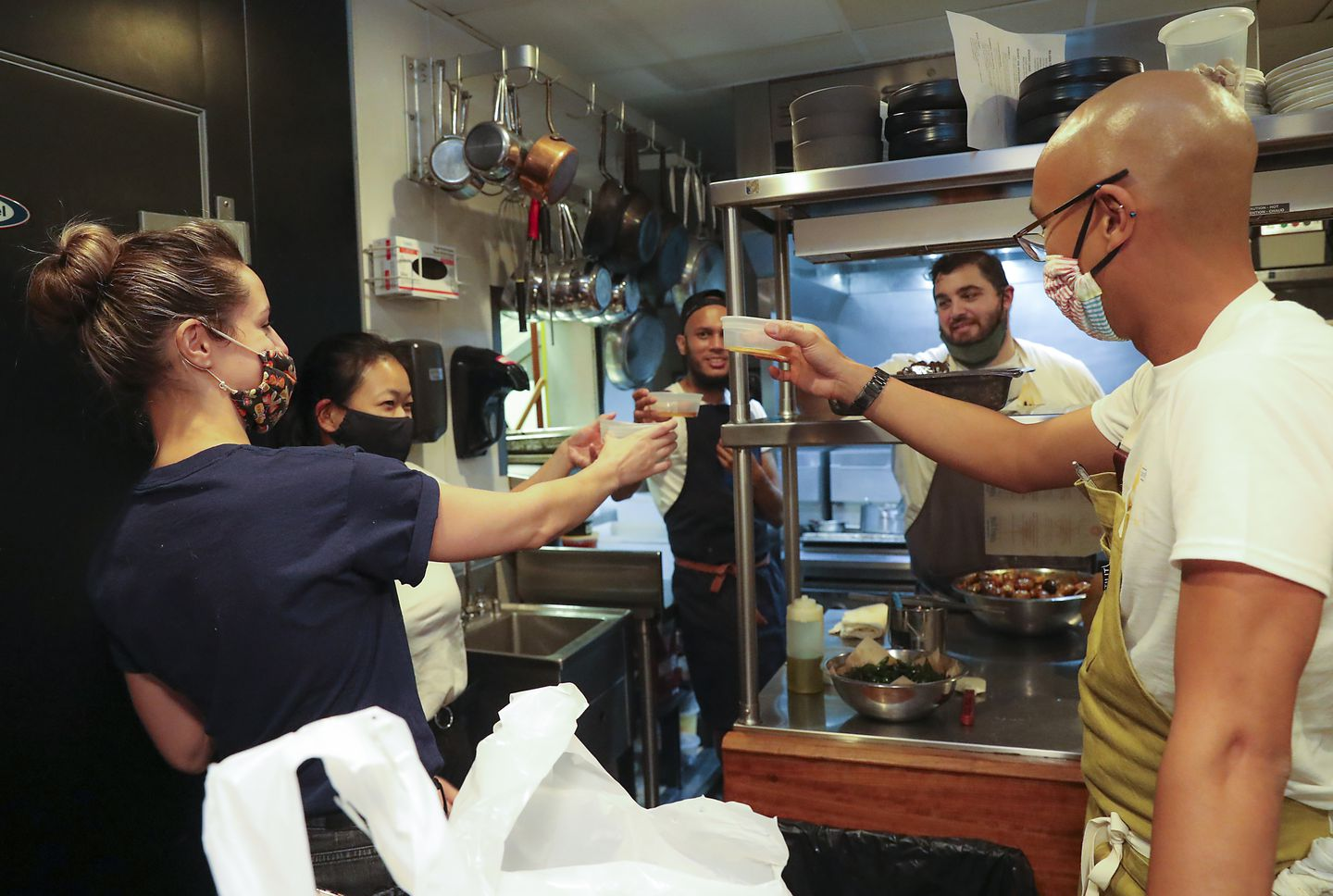 """The crew (left to right) Kate Hardy, Koharu """"Koko"""" Usui, Mohammed Islam, Kosta Tranxidis, and chef Derrick Teh toasting after they prepared 70 dinners at the Sekali pop-up."""
